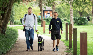 Guide Dogs Association Two Men And A Dog in the Park